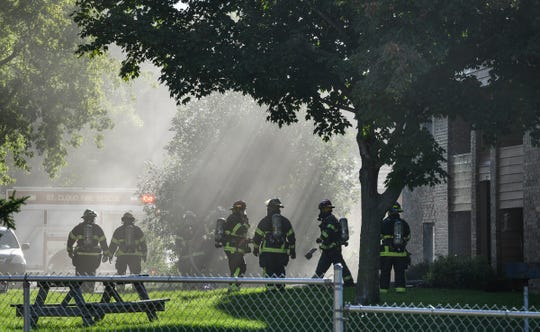 Heavy smoke fills the air as St. Cloud firefighters respond to an apartment fire on 15th Street North Thursday, Sept. 19, 2019, in St. Cloud.