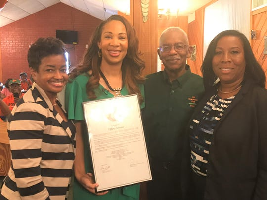 FAMU Major Gifts Officer in the Office of Advancement, Angelia Williams, left, presented Tiffany Greene with a proclamation from the National Alumni Association. She was joined by 220 Quarterback Club president Eddie Jackson and and FAMU Alumni Affairs Director Regina Gardner on Wednesday, Sept. 18, 2019.