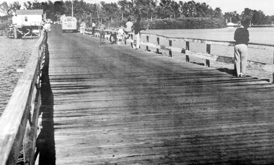 The Wabasso Bridge was once a wooden bridge and is pictured in the 1960s. The bridge tender's home is on the north side.