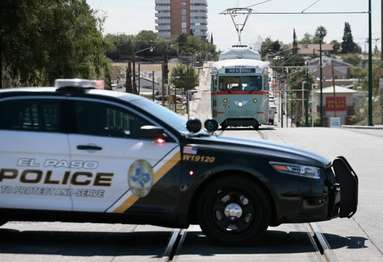 An El Paso police car blocks the road as streetcars stop and wait while detectives investigate a fatal stabbing at North Stanton Street and Cincinnati Avenue on Thursday, Sept. 19, 2019. The man was found stabbed Wednesday night.