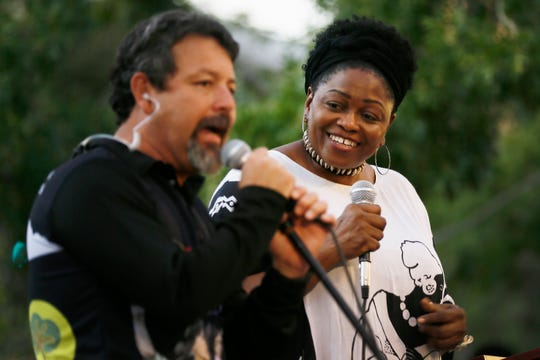 "Yara Allen, of Repairers of the Breach, listens to Fernando Garcia, BNHR executive director, sing after the BNHR and Poor People's Campaign march Wednesday, Sept. 18, as part of the ""We Must Do More"" national tour in El Paso. The started at the corner of Father Rahm Avenue and El Paso Street and ended at San Jacinto Plaza."