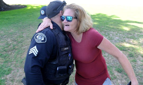 Ventura police Sgt. Mike Anselmo gets a hug from Irene at Plaza Park downtown. Anselmo, along with other individuals, helped her out of an encampment near the Santa Clara River.