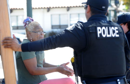 Maria, a  homeless individual, talks with Ventura police officers and Ventura County Behavioral Health. The Ventura Police Department has a mental health services coordinator that assists officers five days a week.