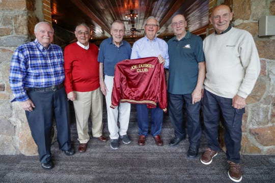 "Jerry Kort, left, Ray Jahns, Dave Hochtritt, Ron Goetzke, Rich Hoffman, and Ron Hoffman, pose for a photo with one of their ""Joe Duskey Club"" jacket Friday, Sept. 6, 2019, at the Granite Peak Ski Chalet in Wausau, Wis. T'xer Zhon Kha/USA TODAY NETWORK-Wisconsin"