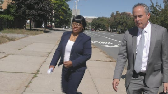 Fraida Hickson leaves federal court in White Plains with her lawyer Kerry Lawrence after she was sentenced to one year of probation for using a stranger's credit to get $7,800 worth of plastic surgery