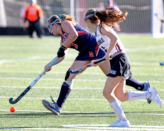 Horace Greeley's Natalie Laskowski (7) pushes the ball up the field during field hockey game at Scarsdale High School Sept.18, 2019. Horace Greeley defeats Scarsdale 4-0.