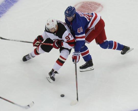 The Rangers' Kaapo Kakko pressures the Devils' Nikita Gusev during their preseason game at Madison Square Garden Sept. 18, 2019. The Devils won 4-3.