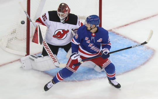 The Rangers' Chris Kreider plants himself in front of Devils' goalie Cory Schneider during a preseason game with the Devils at Madison Square Garden Sept. 18, 2019. The Devils won 4-3.