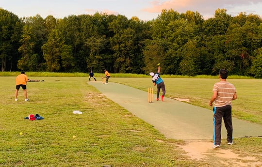 Members of the Lums Pond Cricket Club practice.