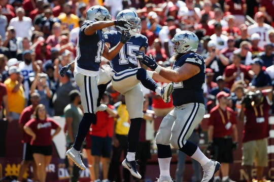 Dallas Cowboys wide receiver Devin Smith (15) celebrates his touchdown with teammates Randall Cobb (18) and Travis Frederick (72) in the first half of an NFL football game against the Washington Redskins, Sunday, Sept. 15, 2019, in Landover, Md. (AP Photo/Alex Brandon)