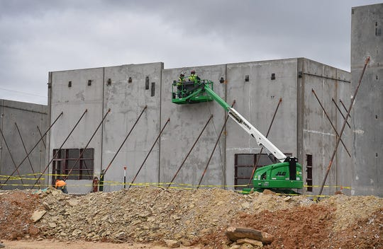 Roof supports are attached to massive concrete walls during construction of the Wichita County Law Enforcement Center Thursday. The $70,000,000 project is due for completion in August of 2020.