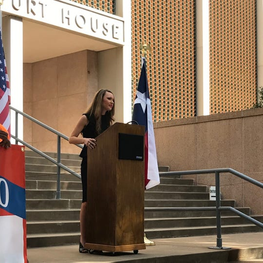 Teea Reed, a longtime friend of Annetta Pope's, gives a short campaign speech during Pope's announcement she is running for Precinct 1, Place 1 justice of the peace for Wichita County Thursday on the steps of the Wichita County Courthouse.