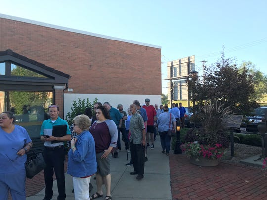 The line for Wednesday's public meeting with ODOT on I-70 reconstruction wrapped around the Zanesville-Muskingum County Welcome Center.