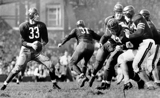 Washington Redskins QB Slingin' Sammy Baugh drops back to pass against the Chicago Bears during a game in 1942.