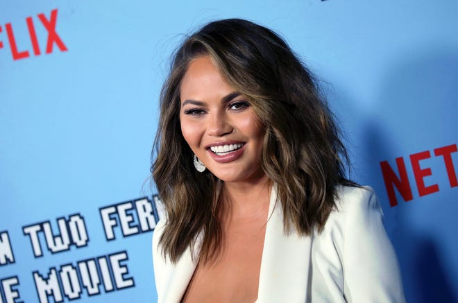 Chrissy Teigen finally got a smooch from her son and captured the adorable moment.