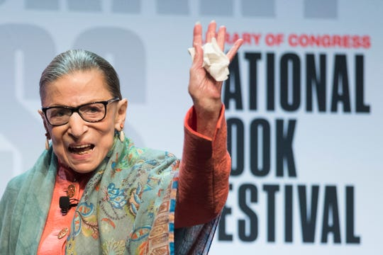 Supreme Court Associate Justice Ruth Bader Ginsburg waves to the audience after speaking at the Library of Congress National Book Festival in Washington on Aug. 31.