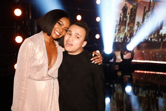 'America's Got Talent' judge Gabrielle Union, who advanced musician Kodi Lee to the live shows with her golden buzzer, celebrates with him after he was crowned Season 14 champ on Wednesday.