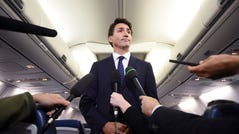 """Canadian Prime Minister and Liberal Party leader Justin Trudeau makes a statement in regards to a photo coming to light of himself from 2001, wearing """"brownface,"""" during a scrum on his campaign plane in Halifax, Nova Scotia, Wednesday, Sept. 18, 2019. (Sean Kilpatrick/The Canadian Press via AP) ORG XMIT: SKP505"""