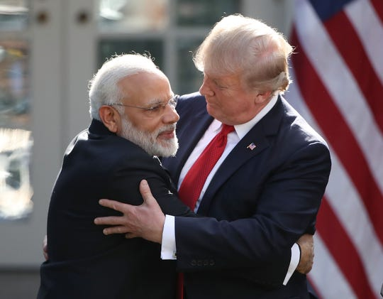 U.S. President Donald Trump and Indian Prime Minister Narendra Modi embrace while delivering joint statements in the Rose Garden of the White House June 26, 2017 in Washington, DC.