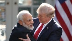 President Donald Trump and Indian Prime Minister Narendra Modi embrace while delivering joint statements in the Rose Garden of the White House June 26, 2017 in Washington, DC.
