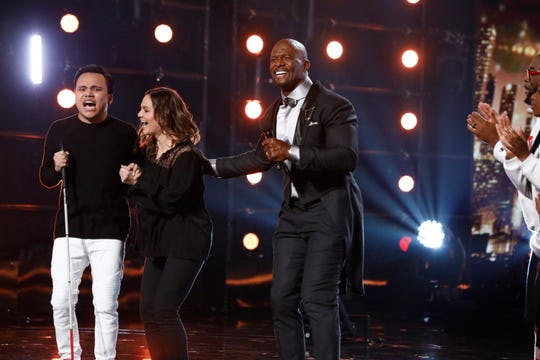 Musician Kodi Lee, left, and his mother, Tina, initiating to hang fun after 'The United States's Bought Abilities' host Terry Crews announced Lee because the Season 14 winner on Wednesday on the Dolby Theatre in Hollywood.