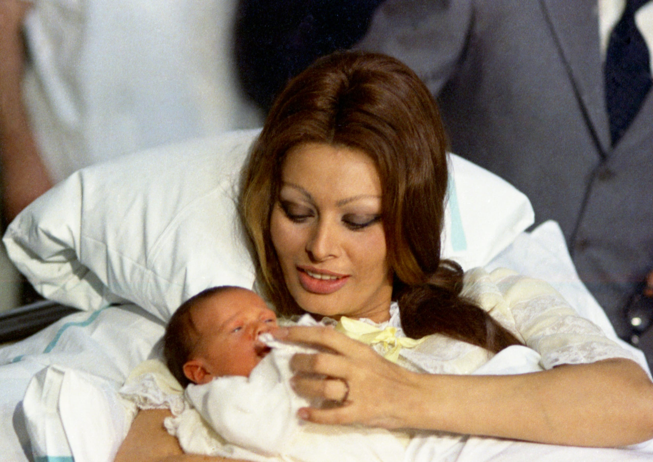 With newborn son Carlo Jr. at Geneva's state hospital clinic on Jan. 4, 1969.