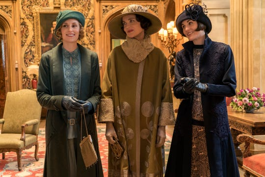 """Lady Edith (Laura Carmichael); her mother, Cora (Elizabeth McGovern); and her sister, Lady Mary (Michelle Dockery), put hats in the spotlight in the film edition of """"Downton Abbey."""""""