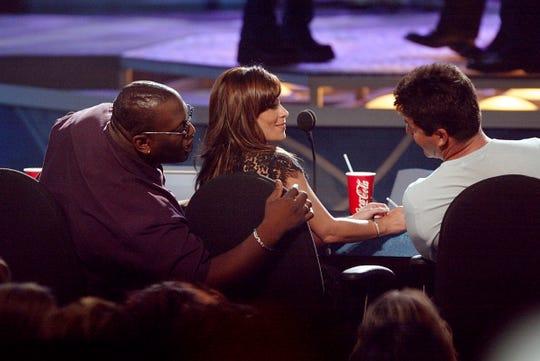 """American Idol"" judges  Randy Jackson, Paula Abdul and Simon Cowell chat during the 2002 season finale."
