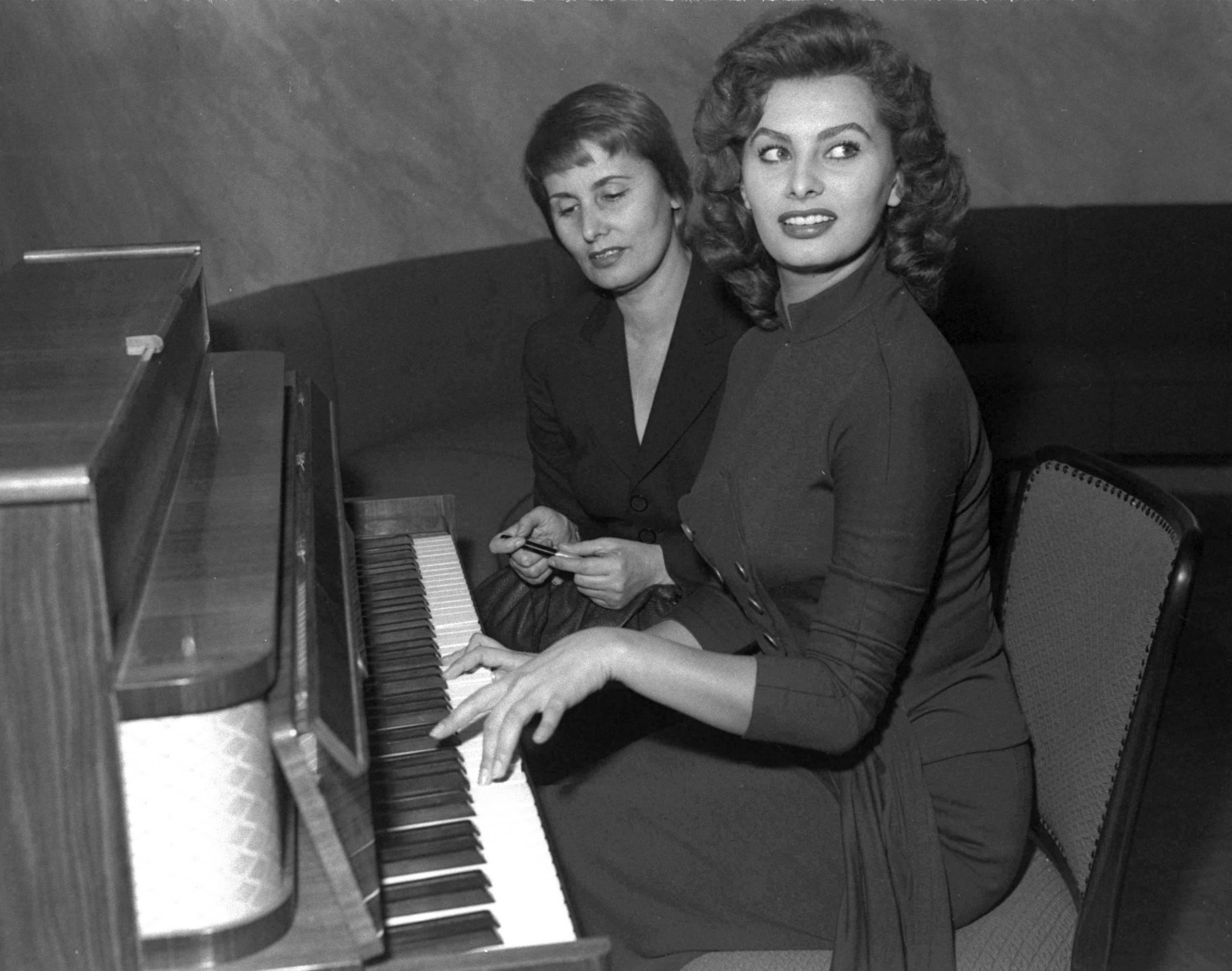 Italian actress Sophia Loren turns 85 on Sept. 20, 2019. She is the only one of the American Film Institute's 25 female greatest screen legends who is still alive. Here, Loren plays piano after a press conference in Munich, Germany, on Feb. 10, 1955. Behind her is her mother, Romilda Villani.