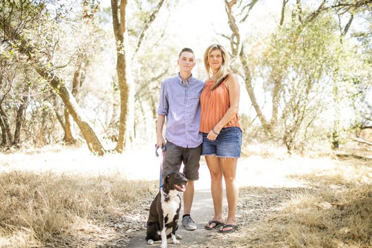 Ricky D'Ambrosio is shown at Folsom Lake near his northern California home with his mother, Christy D'Ambrosio and dog Lucy, who he ran and played with at the lake before his hospitalization for vaping related lung illness.