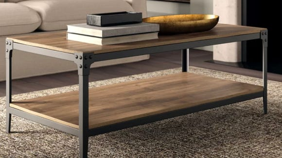 Industrial yet rustic, this coffee table adds a classic touch to living rooms.