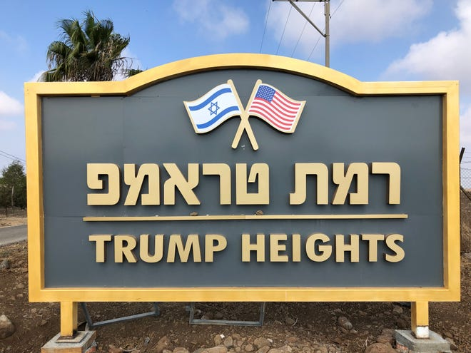 """The sign for """"Trump Heights,"""" a planned Israeli development in the Golan Heights intended to recognize President Donald Trump's pro-Israel policy actions."""