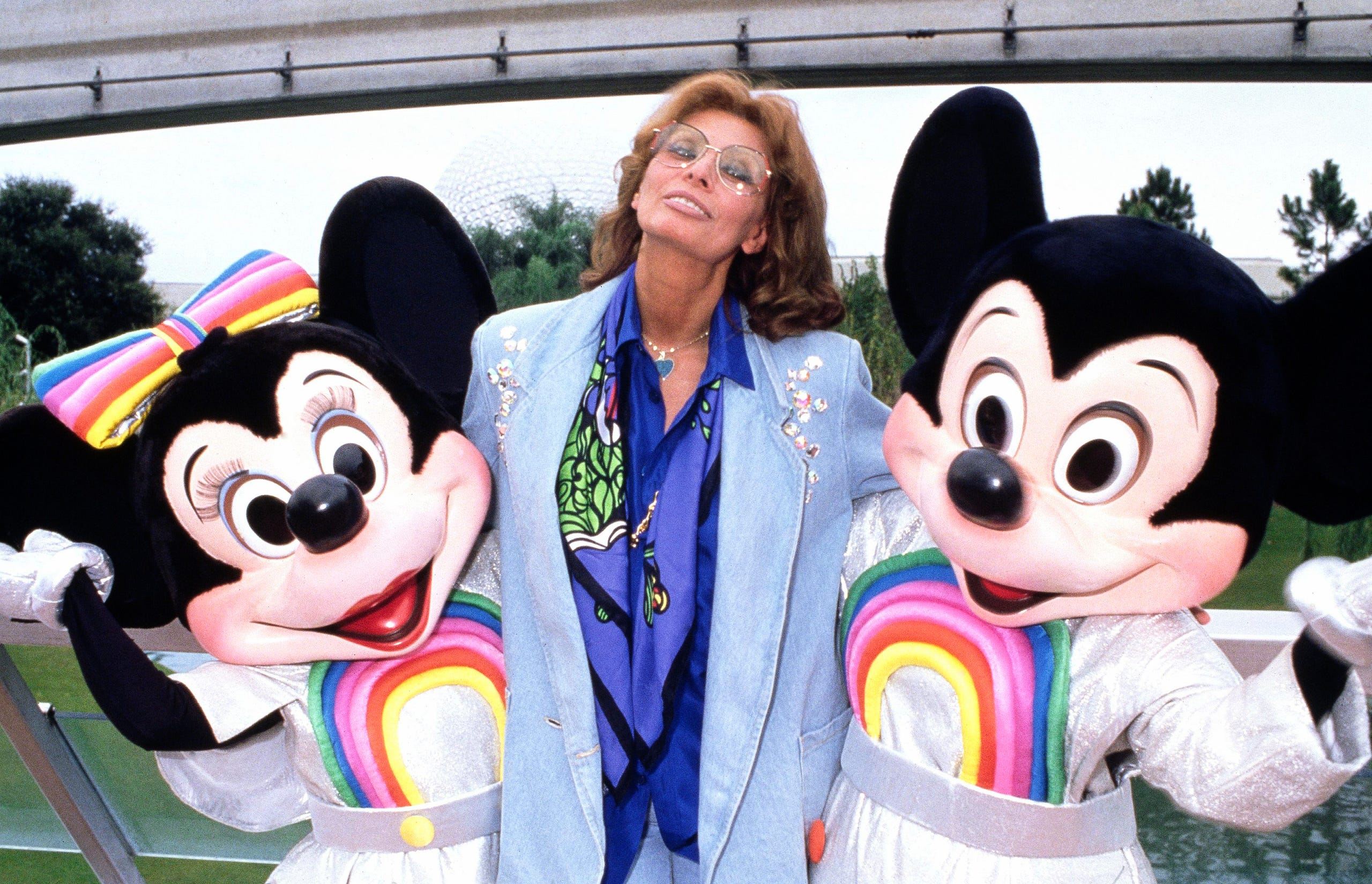 The actress with Mickey and Minnie Mouse at Epcot Center in Florida in December 1986. Loren is the tall one.