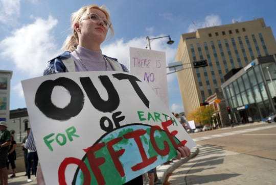 Kelly Jones, Appleton East High School, joins a crowd at Houdini Plaza during the Global Climate Strike on Friday, September 20, 2019, in Appleton, Wis.