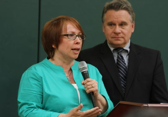 In 2014, Bobbie Gallagher of Brick speaks about raising two children with autism. Rep. Chris Smith is in the background.