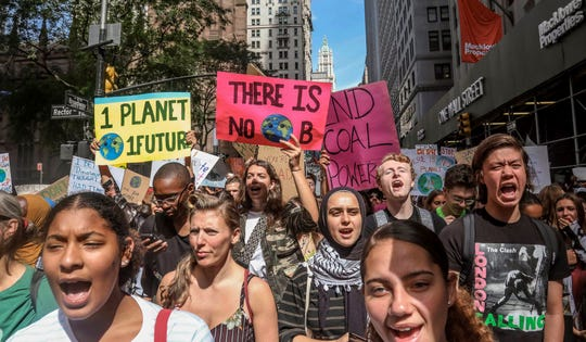Climate change activists participate in an environmental demonstration as part of a global youth-led day of action, Friday Sept. 20, 2019, in New York.  A wave of climate change protests swept across the globe Friday, with hundreds of thousands of young people sending a message to leaders headed for a U.N. summit: The warming world can't wait for action.  (AP Photo/Bebeto Matthews)