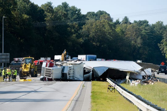 A tractor trailer carrying frozen food overturned after striking a signpost while traveling east on I-40 near exit 53-A on Sept. 20, 2019. The driver of the tractor trailer was transported to Mission Hospital with non-life-threatening injuries.
