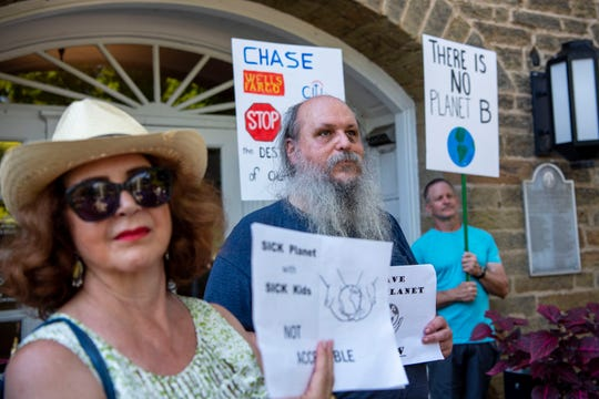 Coco Sweezy and Will Chrisman stand outside city hall, concerned about climate change on Friday, Sept. 20, 2019 in Marshall, Mich. On this day, students around the world skipped school to advocate for legislation that will solve environmental issues.