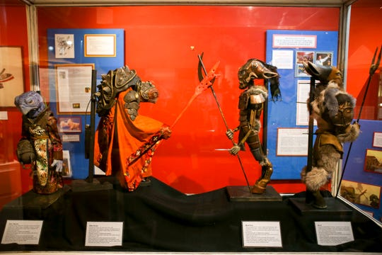 """Four puppets from the movie """"Yamasong-March of the Hollows"""" are displayed at the Valentinetti Puppet Museum in Bremerton."""