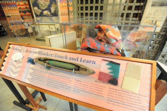 A display in the Beacon Blankets: The Mill exhibit in the Swannanoa Valley Museum & History Center, provides an opportunity to touch materials used by the manufacturer to make blankets. The museum will host Beacon Blankets Make Warm Friends Day on Oct. 5.