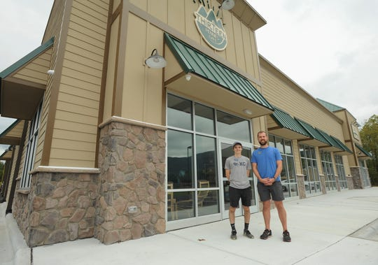 Thirteen Pennies manager Daniel Lancaster, left, and store and cafe director Ben Lillard stand outside of the 15,000-square-foot building that will house the Black Mountain Home for Children's thrift store and cafe.