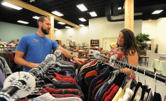 Store and Cafe Director Ben Lillard, of Black Mountain Home for Children, checks in with Mountain Home Thrift Store manager Jessie Ogle, as they prepare or the Oct. 12 ribbon cutting.
