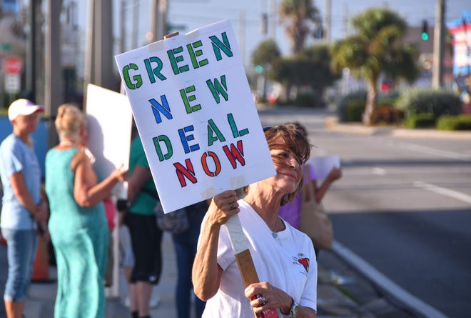 Ellen Jones holds upo her sign. By 9:00 a.m. about 60 protesters had shown up at the intersection of A1A and 520 in Cocoa Beach for a climate strike, a global movement demanding that their government take action on climate change.