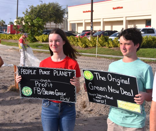 Sophie and Samuel Courtois of Satellite Beach were out with their dad holding up signs. By 9:00 a.m. about 60 protesters had shown up at the intersection of A1A and 520 in Cocoa Beach for a climate strike, a global movement demanding that their government take action on climate change.