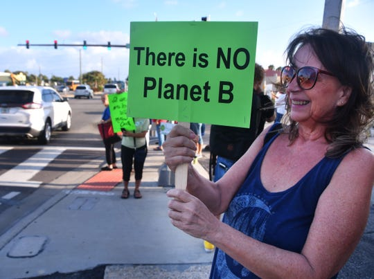In a photo from September 2019, a protester joins others at the intersection of A1A and State Road 520 in Cocoa Beach as part of a global movement demanding that their government take action on climate change.
