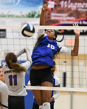 Savanna Wilhite of Heritage blocks the shot of KayLynn Wimberly of Space Coast during Thursday's match in Palm Bay