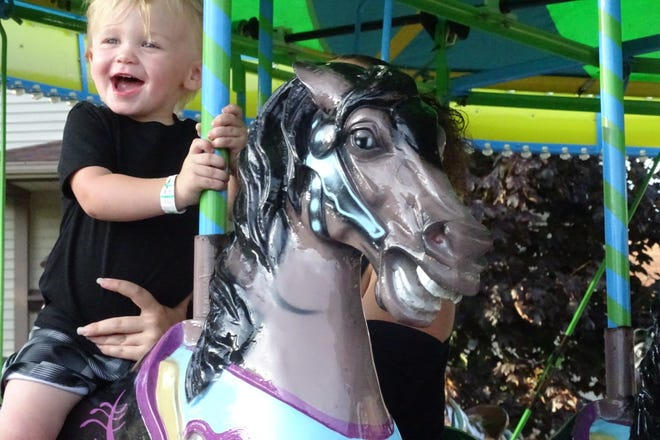 Roman Castle, 2, enjoys a merry-go-round during the 2019 Crestline Harvest Festival. His mom, Chado Horton, was holding him tight.