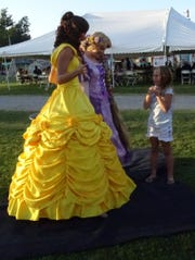 Rhylee Warde, 7, right, chats with Beauty and Rapunzel of A Royal Princess Party.