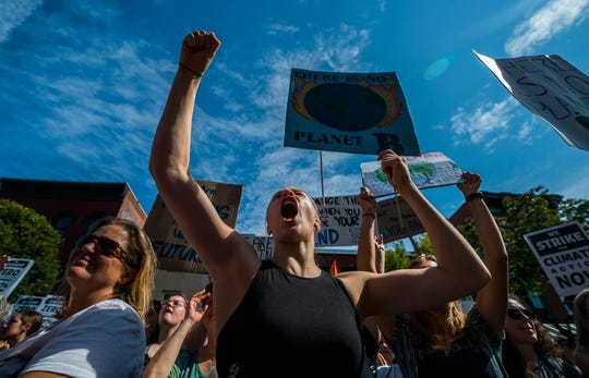 Middlebury High School student Eva Phair cheers along with thousands packing Church Street in front of Burlington City Hall on Friday, Sept. 20, 2019, for the Vermont Climate Strike Rally, part of the Global Climate Strike worldwide to draw attention to climate change.
