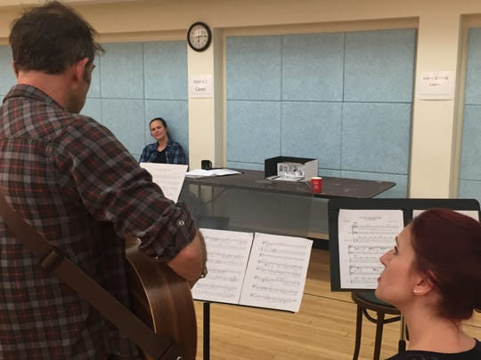 "Jamien Forrest, director of ""The Last Wide Open,"" watches as Jordan Gullikson and Charlotte Munson rehearse for the Vermont Stage play at the Elley-Long Music Center in Colchester on Sept. 18, 2019."